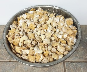 puppy chow chex cheerios nuts oil powdered sugar mixed