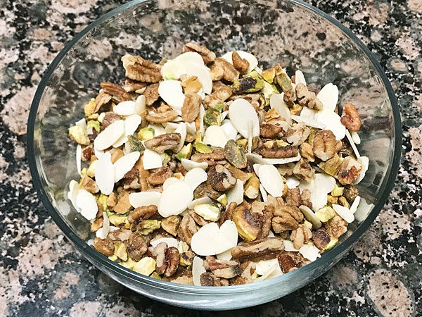 bowl of pistachios, walnuts and almonds for topping