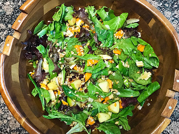 Farro Salad bowl with greens, veggies and fruit