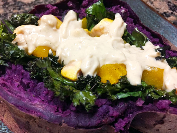 stuffed purple sweet potatoes with lemon tahini sauce