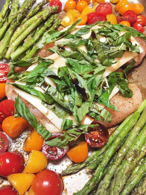 pre-baked sheet pan bruschetta chicken with tomatoes and asparagus