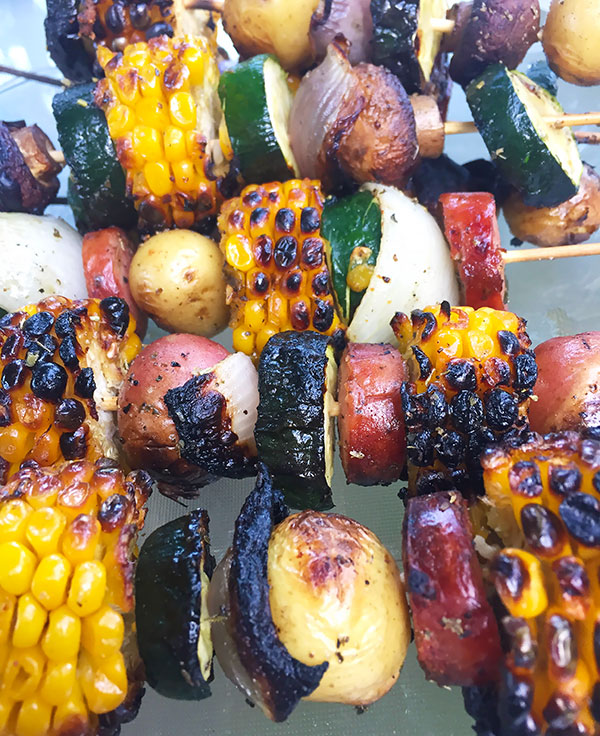 grilled Italian skewers with zucchini, potatoes, corn, sausage and mushrooms