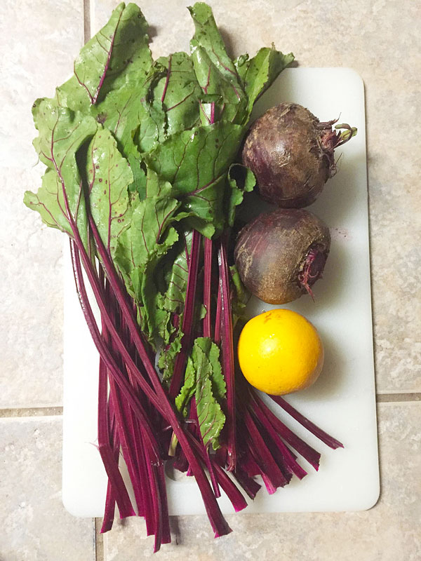 whole beets with greens and oranges