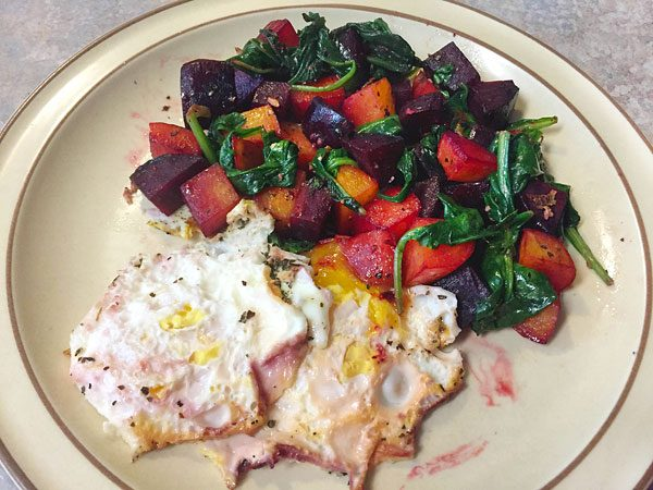 over easy eggs with beets and spinach
