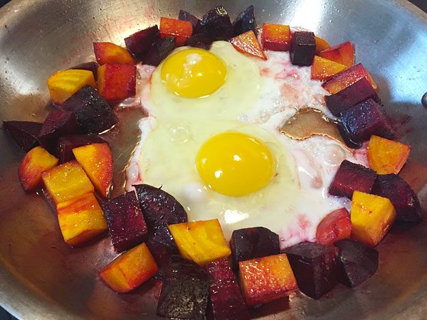 beets and eggs in skillet