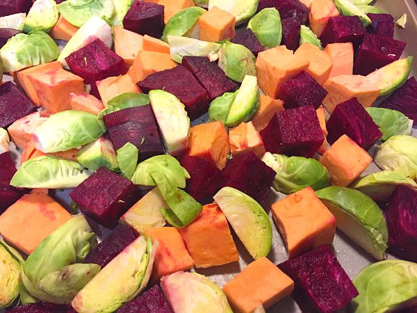 chopped sweet potatoes, brussels sprouts and beets