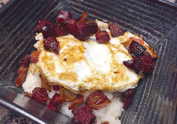 beet and bacon topped egg and grits