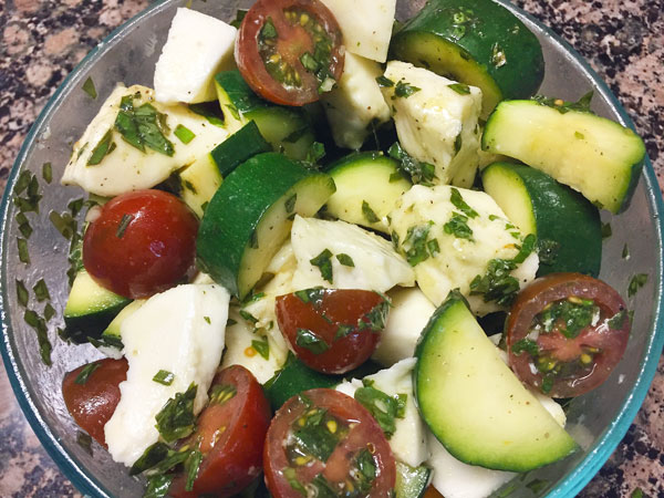 marinated tomatoes, zucchini, yellow bell peppers and mozzarella