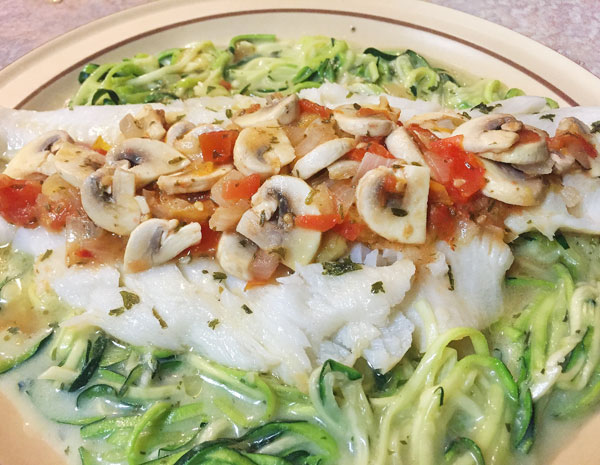 Turbot with lemon butter and sautéed veggies over noodles