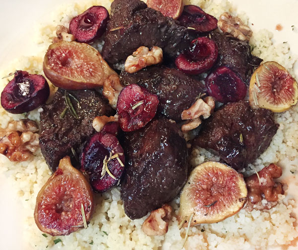 Steak tips with figs, cherries and walnuts over cous-cous