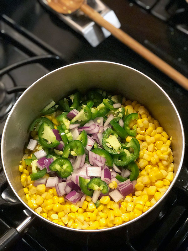 pre cooked creamed corn and veggies on the stove